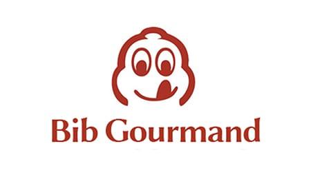 Символ «вилка и ложка» в ресторанном хозяйстве (Bib Gourmand)